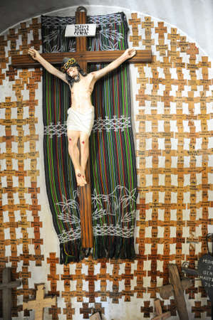 crucifixes: crucifix of the indians killed by the army in the church of Nebaj on Guatemala