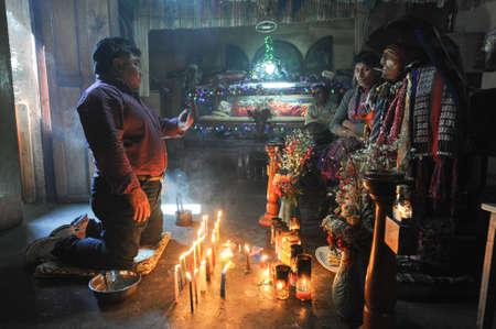 divinity: Maya shaman with the divinity of Maximon at Santiago de Atitlan on Guatemala, 11 February 2014