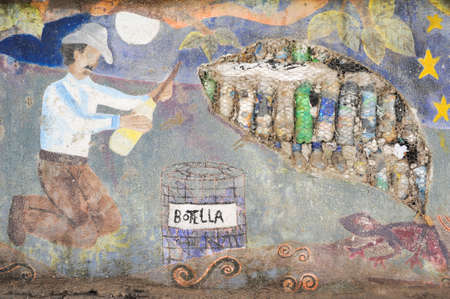 marcos: Wall with pet bottles at San Marcos la laguna Editorial