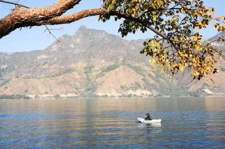 San Pedro la Laguna, Guatemala - 10 February 2014  Mayan indigenous fishing on his canoe at San Pedro on lake Atitlan, Guatemala