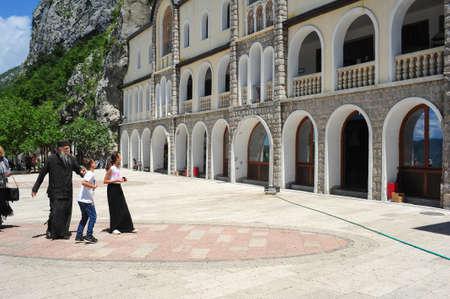 believers: Ostrog, Montenegro - 27 June 2014  believers visiting the Ostrog monastery near Danilovgrad on Montenegro Editorial