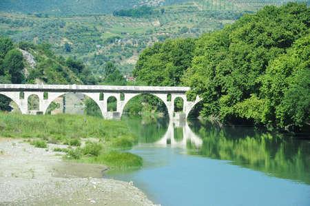 bri: Stone bridge over Osum river at Berat on Albania