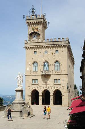 san marino: Borgo Maggiore, San Marino - 4 July 2014: tourists visiting Liberty square in front of public palace at Borgo Maggiore on San Marino