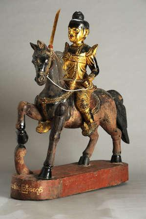 nat: Burmese statue of Nat on a horse Stock Photo