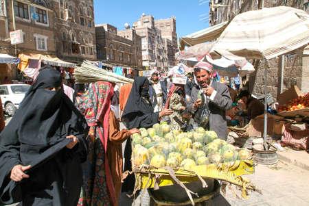 burqa: Sana, Yemen - 1 January 2008: people walking and buying on the market of old Sana on Yemen