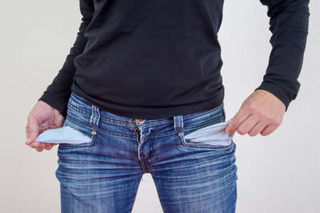 Woman showing empty pockets without money