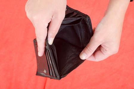 empty wallet: Hands holding an empty wallet