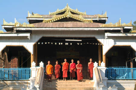 Lake Inle, Myanmar - 14 January 2010: young monks posing in front of Maing Thauk forest monastery on Myanmar