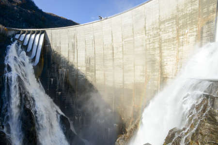 The dam of Verzasca on the italian part of Swtzerland with open the floodgates Editorial