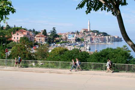 Rovinj, Croatia - August 24, 2004: People walking in front of Rovinj on Croatia