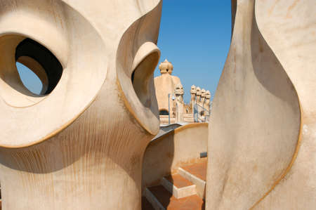 BARCELONA, SPAIN - 15 July 2004: Casa Mila or La Pedrera in Barcelona, ??Spain. This famous building was designed by Antoni Gaudi and is one of the most visited of the city