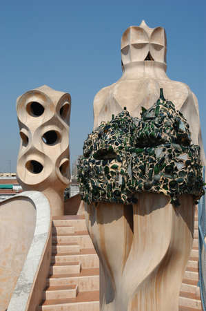 famous building: BARCELONA, SPAIN - 15 July 2004: Casa Mila or La Pedrera in Barcelona, ??Spain. This famous building was designed by Antoni Gaudi and is one of the most visited of the city Editorial