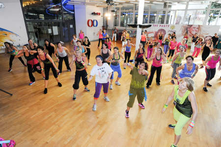 zumba: Lugano, Switzerland - 10 november 2013: People dancing during Zumba training fitness at a gym of Lugano on Switzerland Editorial