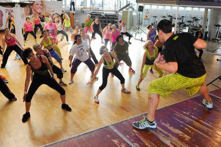 hop: Lugano, Switzerland - 10 november 2013: People dancing during Zumba training fitness at a gym of Lugano on Switzerland Editorial