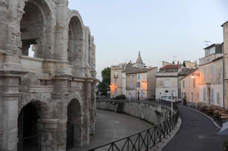 arles: Arles, France -  27 June 2012: People walking in front of the amphithater at Arles on France