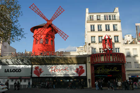 notorious: Paris, France - 3 November 2002: Moulin Rouge is the most famous Parisian cabaret and it created the modern can-can dance