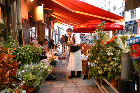 brasserie: Paris, France - 1 November 2002: People eating and drinking in a street restaurant of Paris on France
