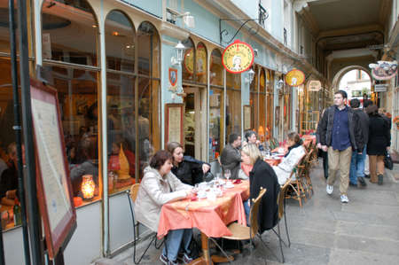 Paris, France - 1 November 2002: People eating and drinking in a street restaurant of Paris on France
