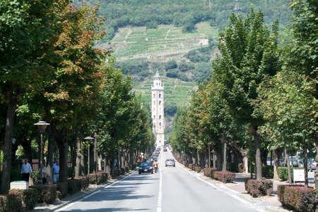 Tirano, Italy - 22 July 2007: People on the avenue to Basilica  of Madonna at Tirano on Italy