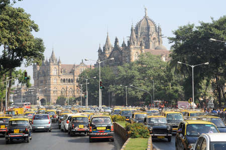 terminus: Mumbai, India - 5 january 2015: People on the traffic in front of Chhatrapati Shivaji Terminus formerly Victoria station at Mumbai, India Editorial