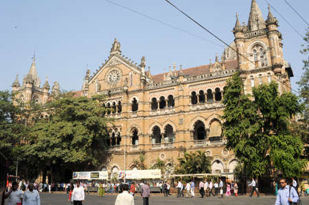 terminus: Mumbai, India - 5 january 2015: People walking in front of Chhatrapati Shivaji Terminus formerly Victoria station at Mumbai, India