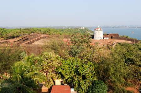 aguada: Lighthouse in Aguada fort, located near Sinquerim beach, Goa, India