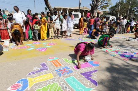 chalks: Hampi, India - 11 January 2015: Woman during a street design competition at Hampi on India Editorial