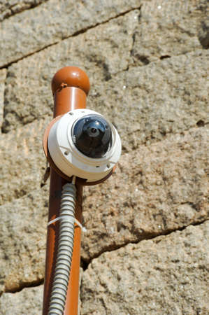 remote controlled: Remote controlled security camera on a wall Stock Photo
