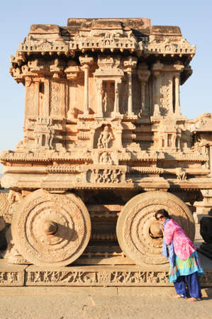 chariot: Hampi, India - 12 January 2015: Tourist posing in front of Chariot in Vittala temple at Hampi on India