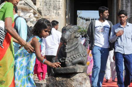nandi: Hampi, India - 11 January 2015: Indian people brings offerings to Nandi Bull at Virupaksha Temple in Hampi