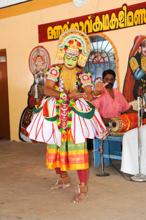 narration: Kollam, India - 18 January 2015: a storyteller with his band performing dance and music at the festival of Kollam on India