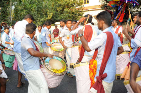 newsworthy: Kollam, India - 18 January 2015: People playing music and dancing at the hindu carnival festival of Kollam on India Editorial