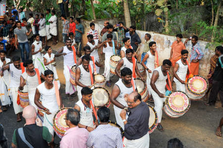 satirical: Kollam, India - 18 January 2015: People playing music and dancing at the hindu carnival festival of Kollam on India Editorial