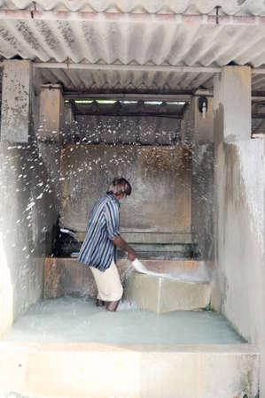 man laundry: Fort Cochin, India - 16 January 2015: Man washing laundry at Fort Cochin on India Editorial