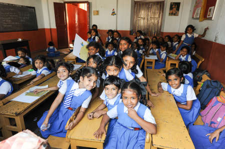 uniforms: Fort Cochin, India - 22 January 2015: pupils in classroom at them school of Fort Cochin on India Editorial