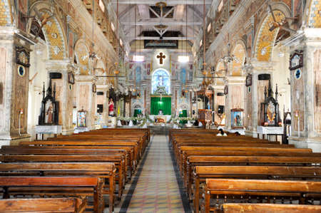 prying: Fort Cochin, India - 22 January 2015: People prying on the interior of Santa Cruz Cathedral at Fort Cochin on India