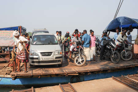 backwaters: Kollam, India - 19 January 2015: People crossing a river of the backwaters on a ferry at Kollam on India Editorial