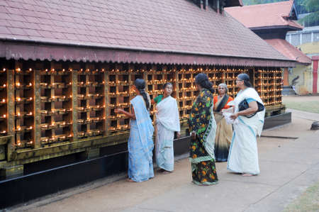 believers: Kollam, India - 19 January 2015: believers praying at the hindu temple of Kollam on India