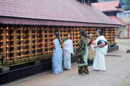 believers: Kollam, India - 19 January 2015: believers praying at the hindu temple of Kollam on India