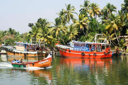 alappuzha: Kollam, India - 20 January 2015: Fishing boat on the river near Kollam on Kerala backwaters, India Editorial
