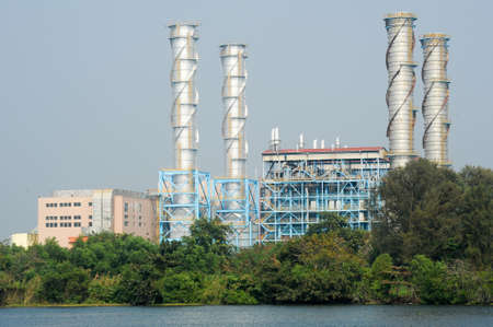 alappuzha: Heavy industry on the backwaters the way from Kollam to Alleppey on Kerala, India Stock Photo