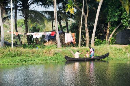 alappuzha: Kollam, India - 20 January 2015: A family cruising on a canoe near Alleppey on Kerala backwaters, India