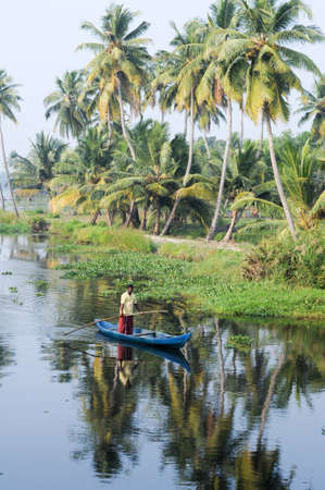 india fisherman: Kollam, India - 20 January 2015: Fisherman cruising on a canoe near Alleppey on Kerala backwaters, India