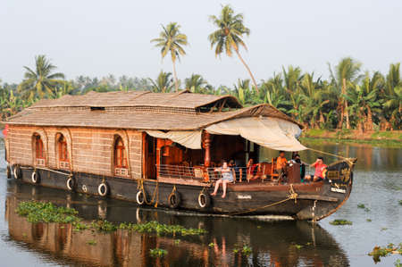 alleppey: Alleppey, India - 20 January 2015: Traditional Indian houseboat cruising near Alleppey on Kerala backwaters