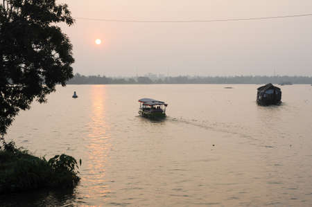 backwaters: Traditional Indian houseboat cruising near Alleppey on Kerala backwaters