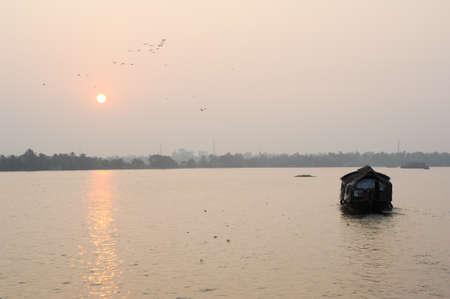 kerala backwaters: Traditional Indian houseboat cruising near Alleppey on Kerala backwaters