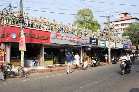 alappuzha: Alleppey, India - 21 January 2015: People walking on the street in front of a indu temple at Alleppey, India Editorial