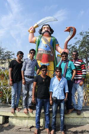 mahishasura: Mysore, india - 23 January 2015: People posing in front of statue of the mythological hindu demon Mahishasura on the top of Chamundi Hill, Mysore