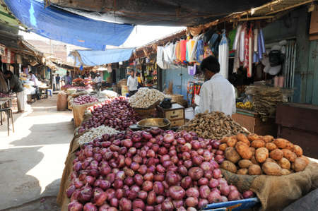 mysore: Mysore, India - 23 January 2015:  Indian vendors and customers in the Devaraja vegetable market at Mysore on India