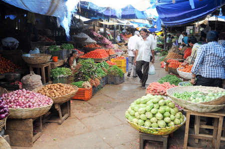 mysore: Mysore, India - 24 January 2015:  Indian vendor selling vegetables to the customers in the Devaraja  market at Mysore on India